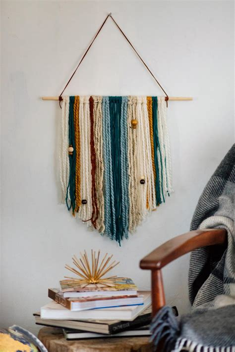 How To Make Handmade Wall Hangings - how to make an easy diy yarn wall hanging hgtv