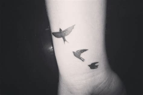 small black bird tattoos black small bird tattoos on wrist tattooshunt