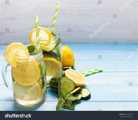 Detox Water Italiano by Lemon Cucumber Detox Water Glass Jars Stock Photo