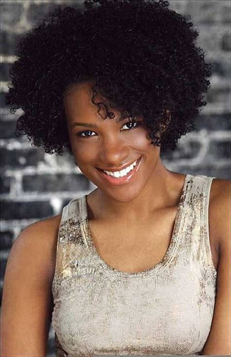 a natural afro cut style long on top and the sides and back on the hair is cut very low for a black lady to wear with pics afro hairstyles for short hair the best short hairstyles