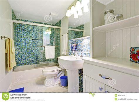 Refreshing White Bathroom With Aqua Tile Wall Trim Stock