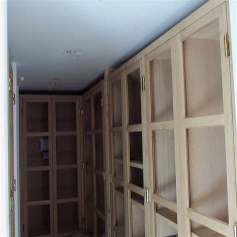 Closet with double hanging pole Ideal Cabinets Inc.