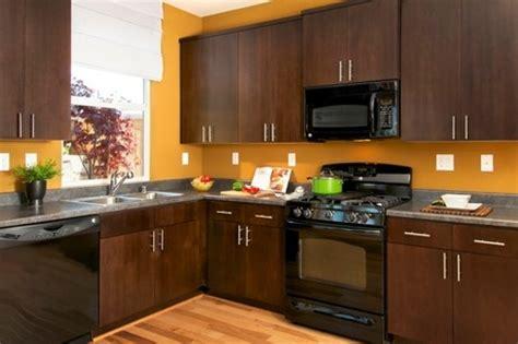 dark brown kitchen cabinets with black appliances sleek black appliances and polished aluminum handles