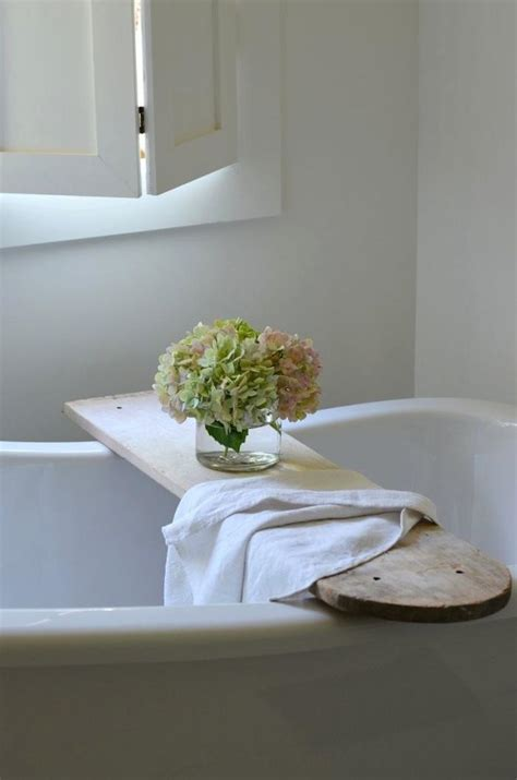 bathtub table tray turn a vintage ironing board into a stunningly useful table