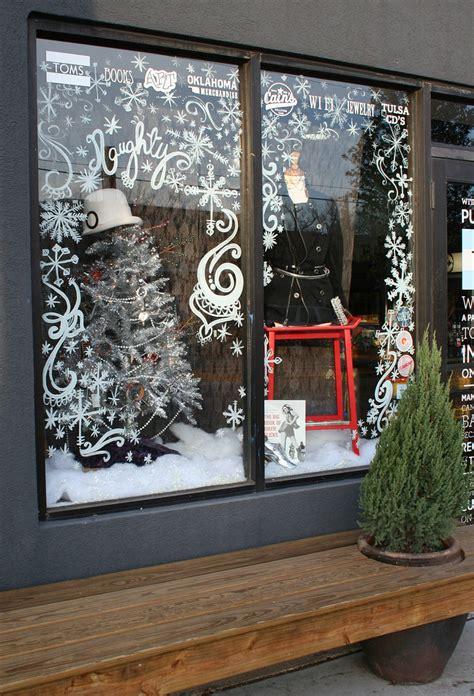 window painting for christmas window display kara paslay design