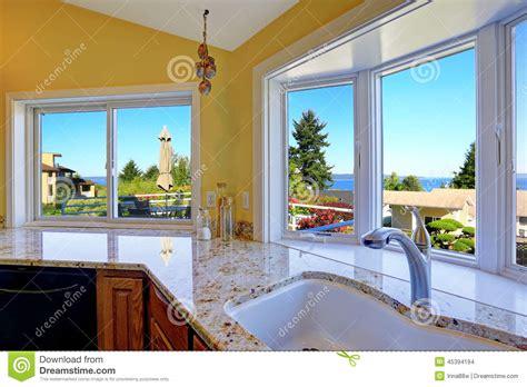 beautiful window kitchen cabinet with granite tops and beautiful window