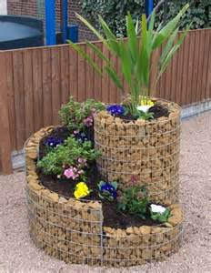 really great looking raised flower bed garden art