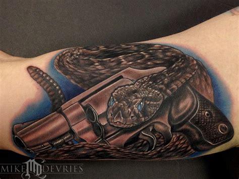 tattoo guns for sale near me snake and gun tattoo by mike devries tattoonow