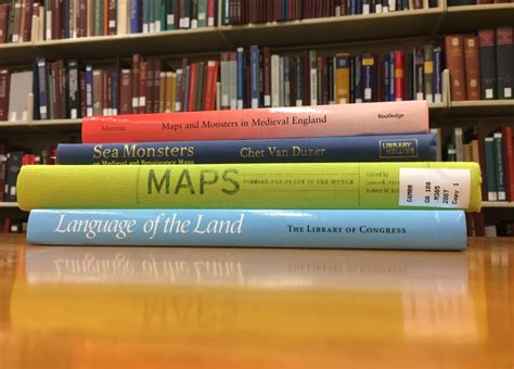 reference books at the library literature worlds revealed geography maps at the