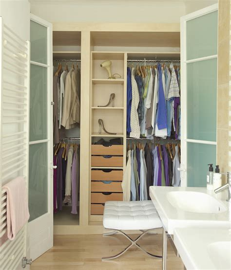 closet in bathroom closet with frosted glass doors contemporary closet