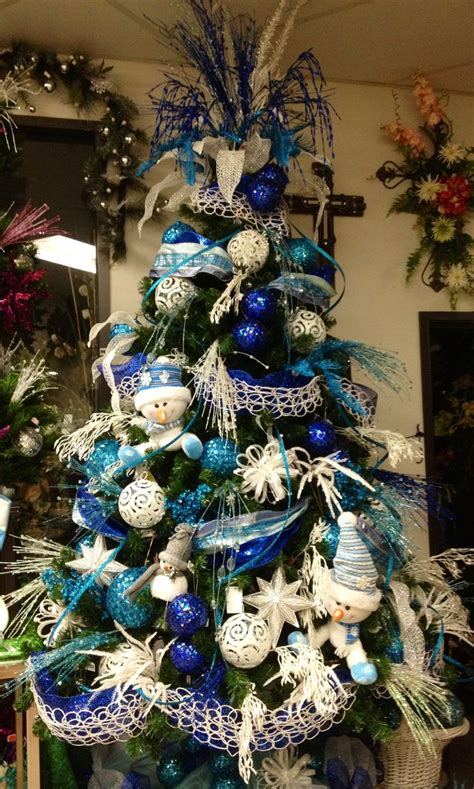 traditionalchristmas tree designed by arcadia floral blue and white snow man christmas tree christmas tree