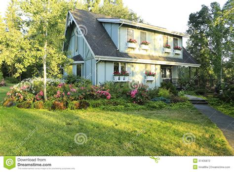 big farmhouse big farmhouse with beautiful flowerbed stock photography