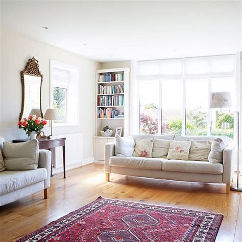 traditional white living room with oak floor living room