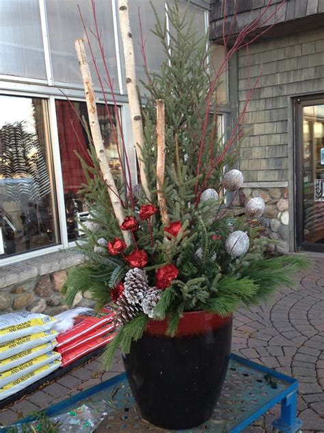 christmas decorating huge stone urns in front of entrance beautiful spruce tip pot the holidays decorations planters