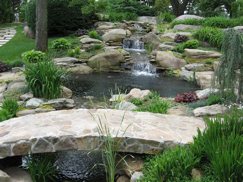 water ponding in backyard backyard waterfalls water garden koi pond and streams with stone bridge by matthew