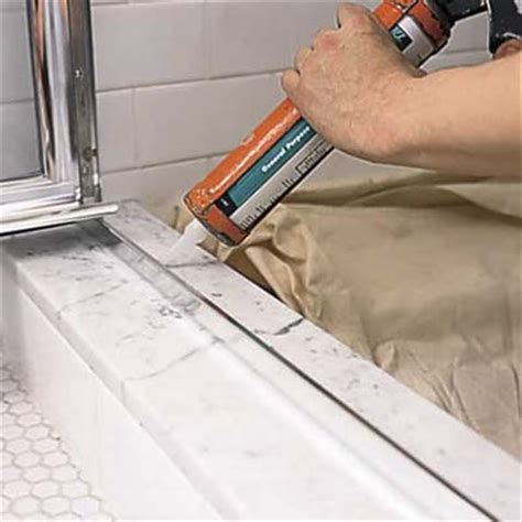 Shower Door Threshold Replacement Apply Silicone Caulk How To Install A Shower Door This House