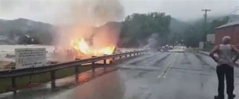West Virginia Burning by Shocked Residents Burning Building Get Swept Away In