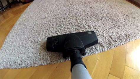 Vacuum Cleaner POV Hoovering Wooden Floor And Carpet Stock