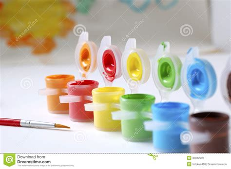 colored paint color paints and paint brush stock photo image of yellow