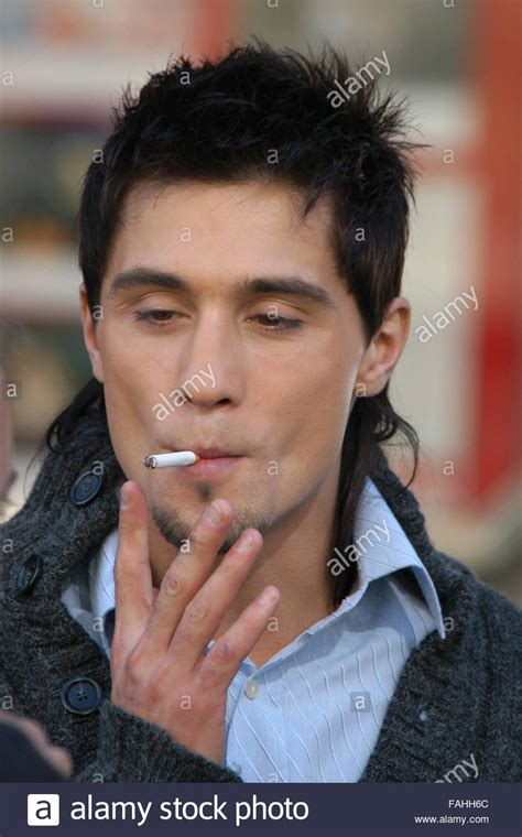 russian singer russian pop singer dima bilan smokes a cigarette during