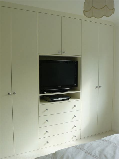 Fitted Wardrobes With Tv Space by Wardrobe Company Floating Shelves Boockcase Cupboards