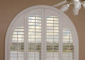 We installed polywood shutters on this arch window and custom designed