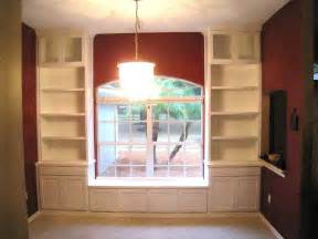 Built In Bookshelves Around Window Hand Made Custom Built In Bookcases Amp Window Seat By