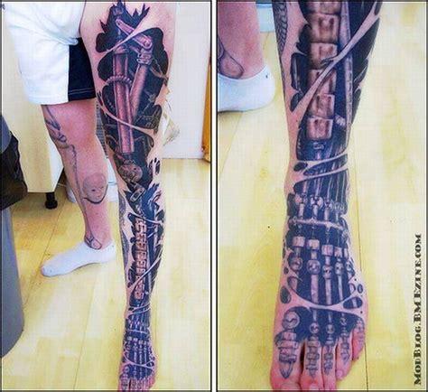 extreme detail tattoo bio mechanical leg piece by peter aurisch tattoo art