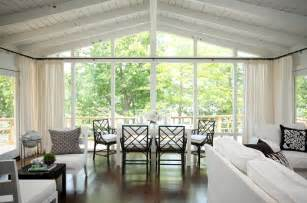 cathedral ceiling curtains floor to ceiling windows transitional dining room