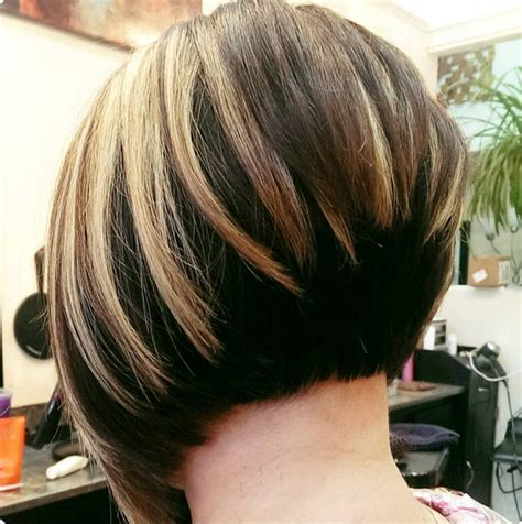 very short hairstyle with highlights lift and a bump on 30 stacked bob haircuts for sophisticated short haired women