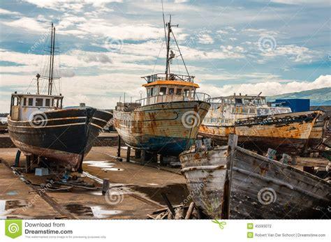 boats yard rusty old boats on boatyard of madalena pico azores stock