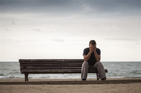 lonely man on bench can loneliness make us sick cbs news