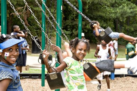 children on swing national playground safety week april 22 26 safe kids