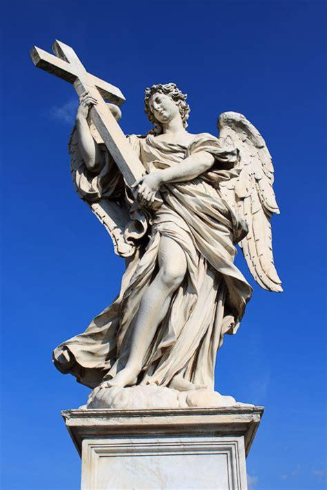 angel holding a cross tattoo ponte sant angelo