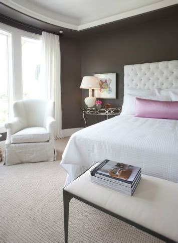 dark brown bedroom walls pink lumbar pillow transitional bedroom dodson and