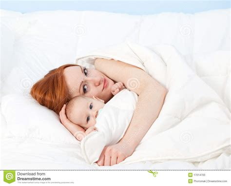 in bed with mom baby boy with mother in bed stock photo image 17014700
