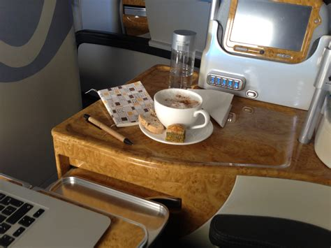 emirates upgrade to business class emirates business class upgrade coffee and biscuits