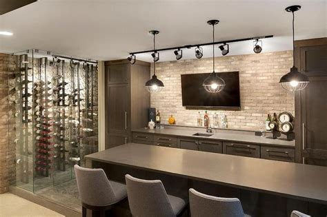 contemporary basement bar features dark brown cabinets