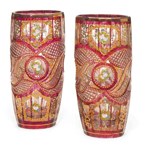 Bohemian Vases Prices by A Pair Of Bohemian Cut And Enamelled Cranberry Stained
