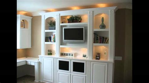 in unit built in white entertainment center cabinets and wall