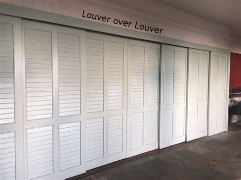 Louvered Bypass Closet Doors Louvered Sliding Closet Doors Gpsolutionsusa