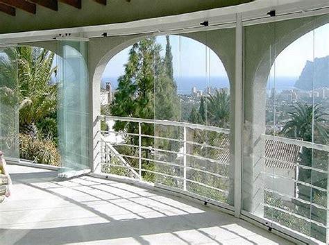 balconi verandati chiusura balcone con vetri e tende antivento e antipioggia