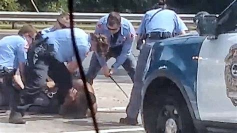 show raleigh police officers beating man