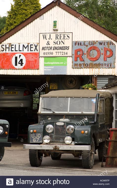 land rover parked outside small fashioned local garage