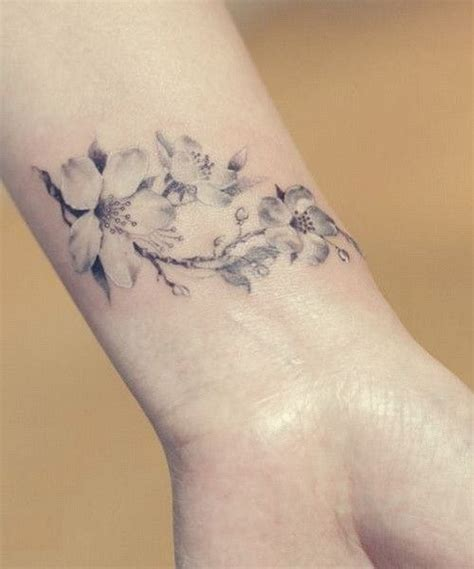 side wrist tattoos for women uncolored cherry blossom for on wrist
