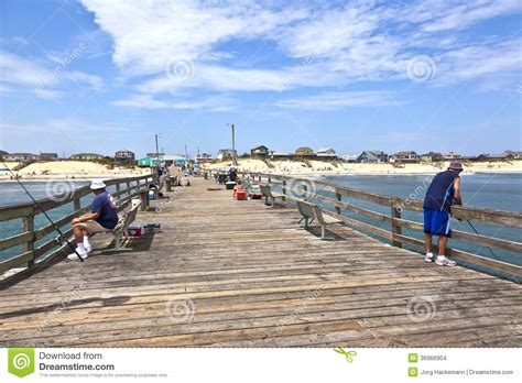 Nags Fishing Pier Cottages by Enjoy Fishing At The Editorial Stock Image