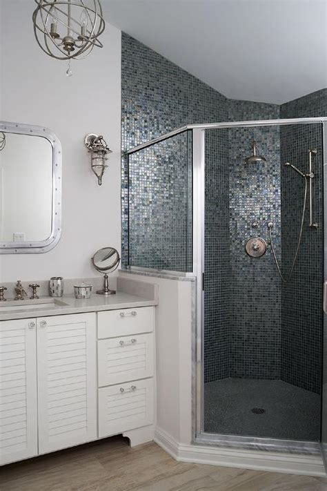 corner shower with blue and gray mosaic glass tiles