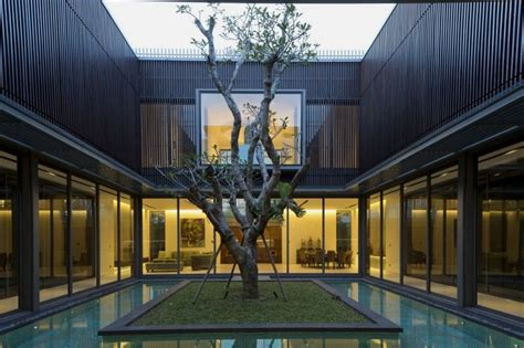 Interior Lighting For Homes by Modern House With Water Surrounded Courtyard In The Center