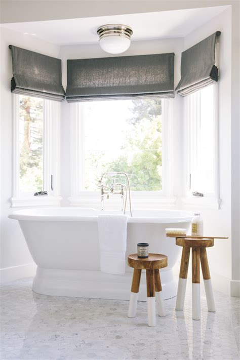 bathroom bay window worlds away gold leafed and antique mirror inset pendant over freestanding bathtub