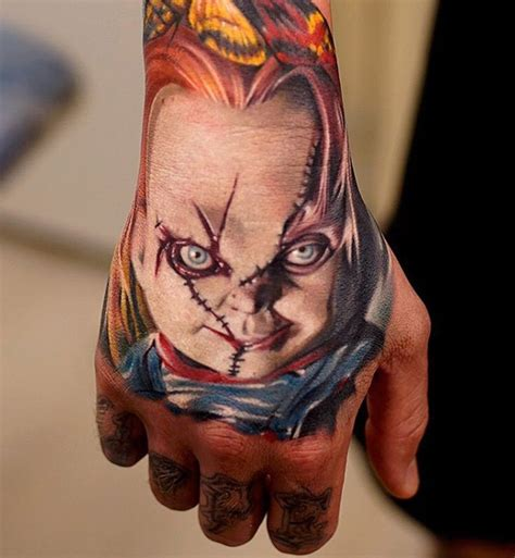 chucky tattoo on guy s hand best tattoo ideas amp designs